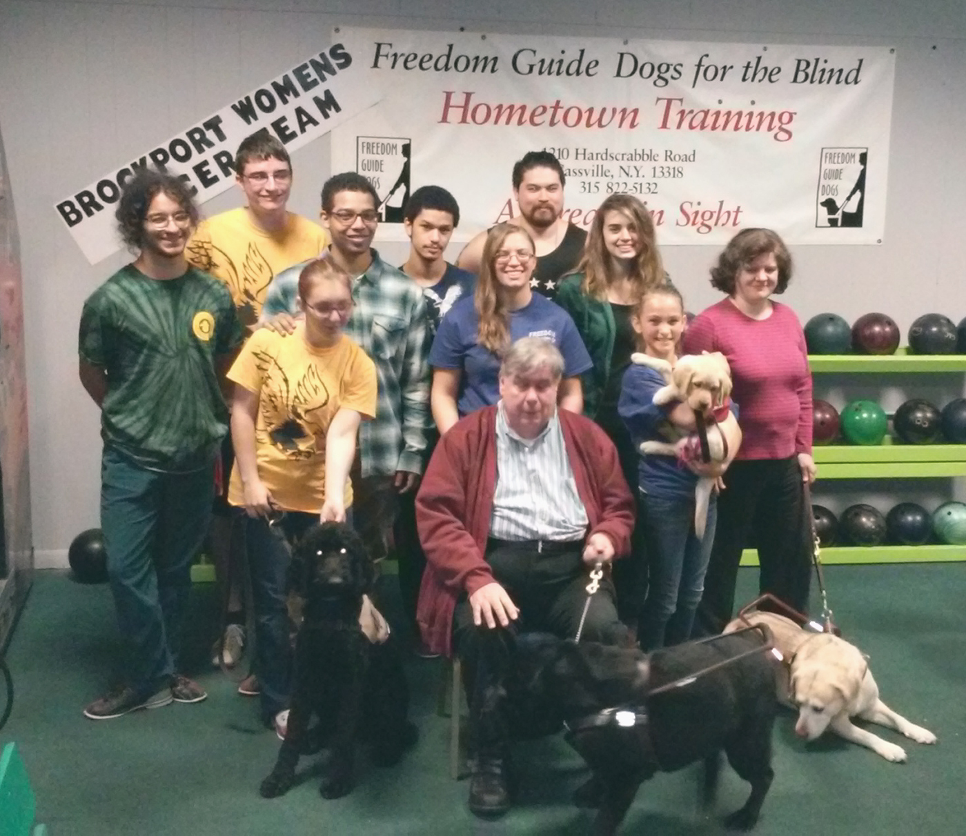 The Judo Club at The College at Brockport. Tom Flaherty, a Freedom Guide Dog graduate (front), and his guide dog partner Biscuit. Provided photo