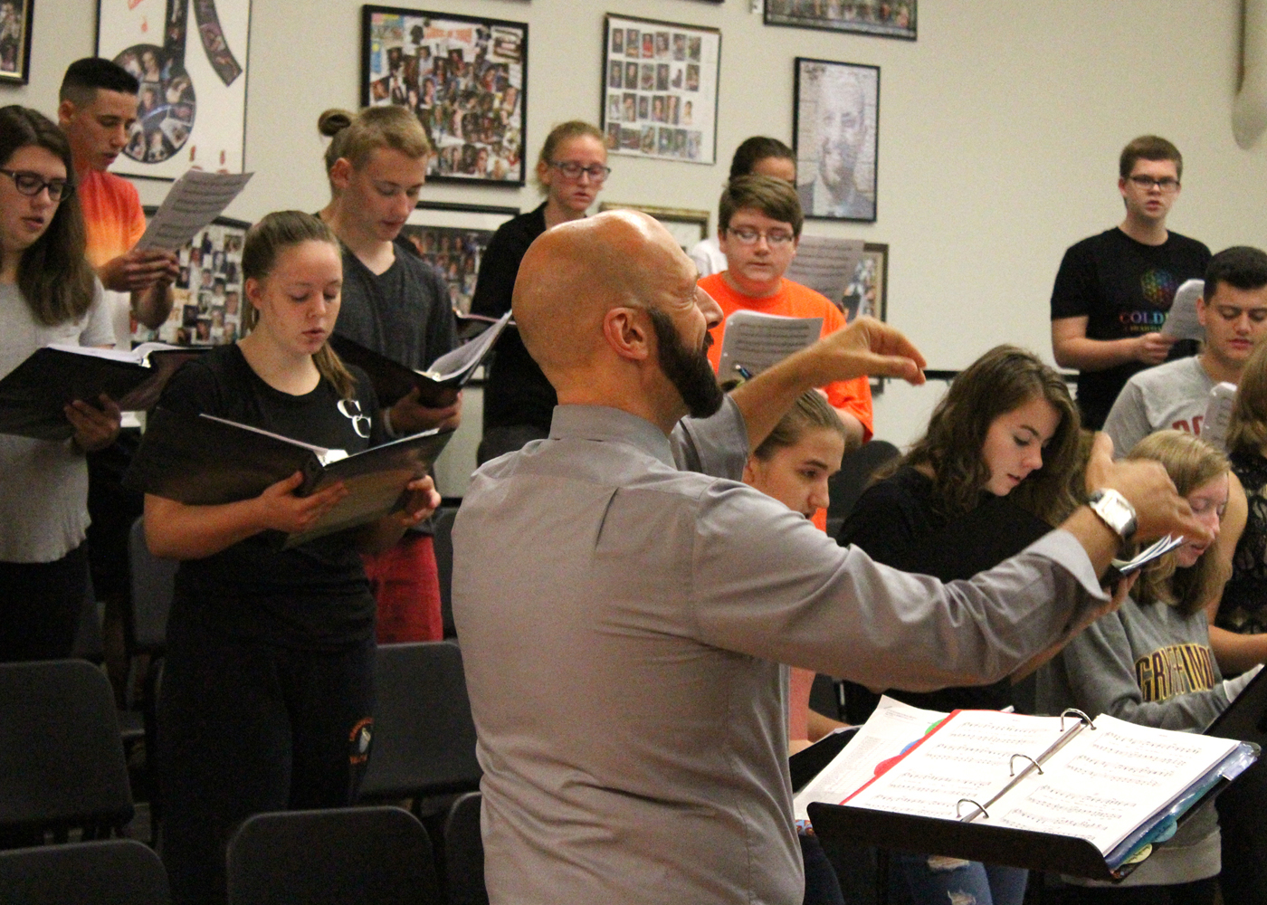 Director Erik Reinhart and the Churchville-Chili Concert Choir rehearse in preparation for their performance at the NYSSMA Winter Conference. Provided photo