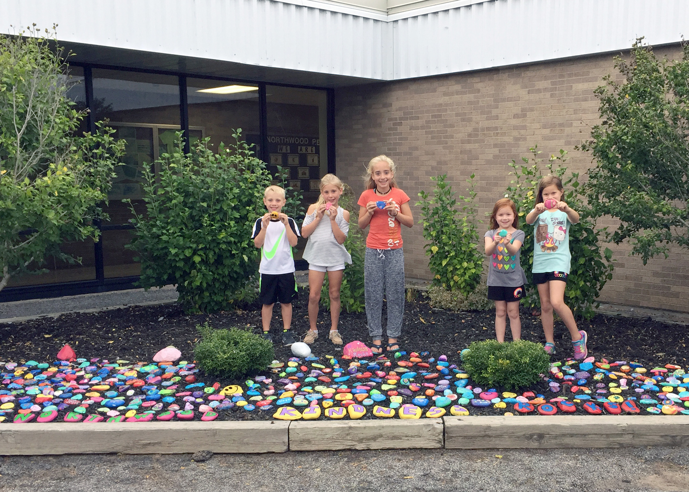 Northwood Elementary School students (l-r) Cole, Madison and Lucy Murphy, and Gianna and Makayla Pignagrande in their school's Kindness Rocks garden. Provided photo