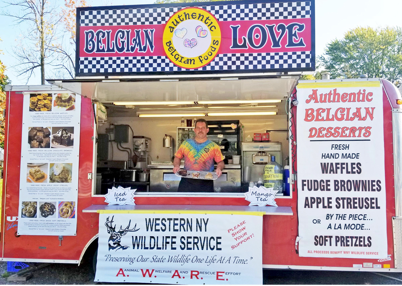 """Belgian Love"" concession trailer boldly announces its food specialties on Main Street in the Capen Hose parking lot. Proceeds go to three not-for-profit organizations. Photo by Dianne Hickerson"