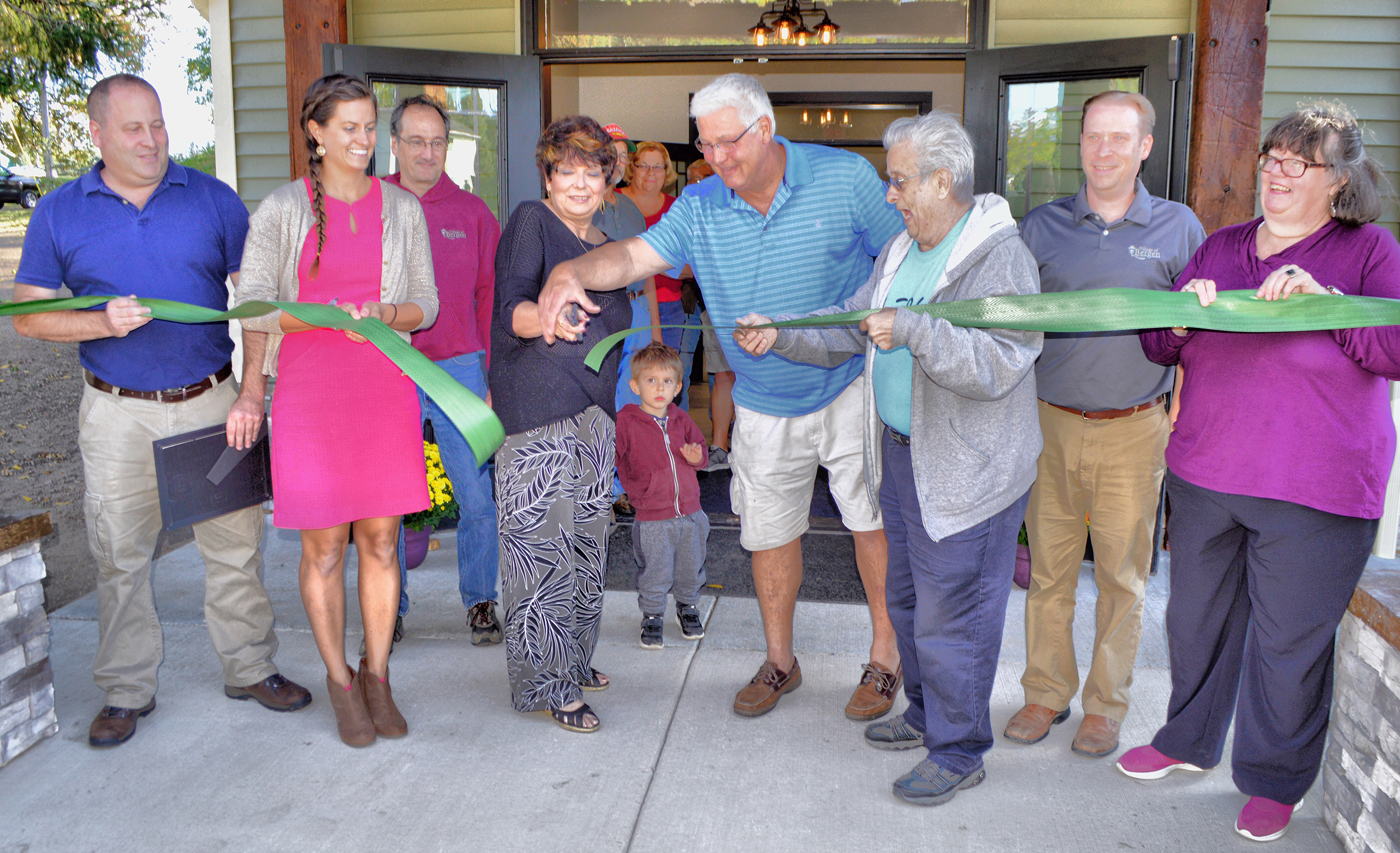 Cutting the ribbon to Sage Pavilion (left to right): Jay Grasso, representative from Senator Ranzenhofer's office; Trustee Emily Van Eenwyk; Trustee Kevin Donovan; Mayor Anna Marie Barclay; Gary Zawodzinski, Village of Bergen DPW Supervisor; Trustee Robert Fedele; Village Administrator/Clerk/Treasurer Cortney Gale and Trustee Vickie Almquist. Photo by Rick Nicholson