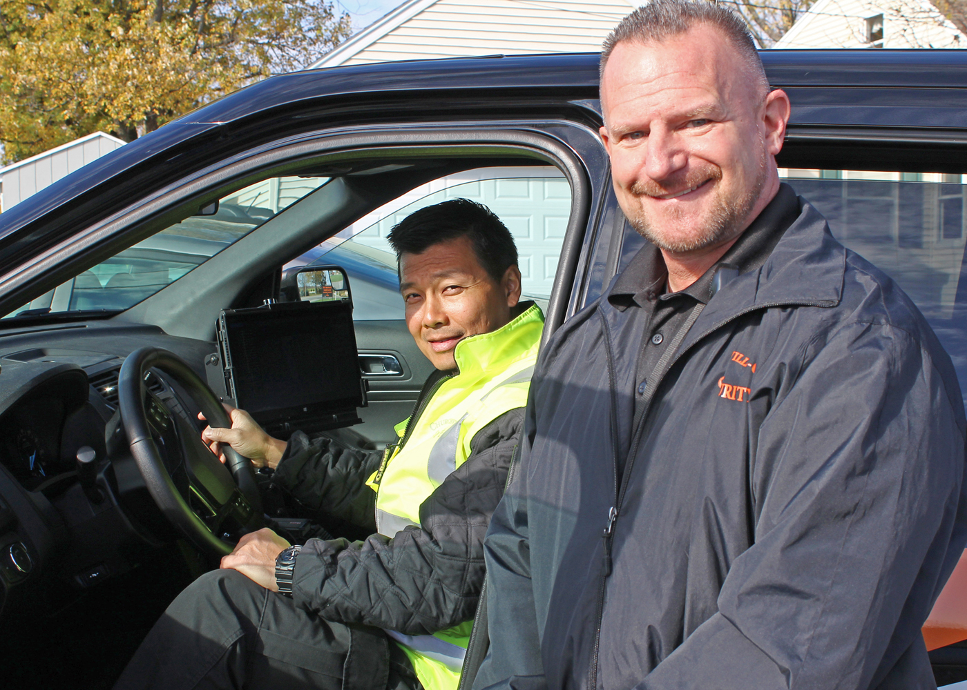 Churchville-Chili Security Officer Rick Allain (l) with Director of School Safety and Security William Sanborn in one of the district's MDC-equipped vehicles. Provided photo