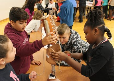 Fourth graders (l-r) Ava Heise, Zack Mattice, Chase Popeliarz and Aniyah Miles assemble a prosthetic leg as part of an engineering unit at Northwood Elementary School in Hilton. Provided photo