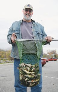Pete McElhatten with a nice mess of fall run perch taken in Irondequoit Bay. Provided photo