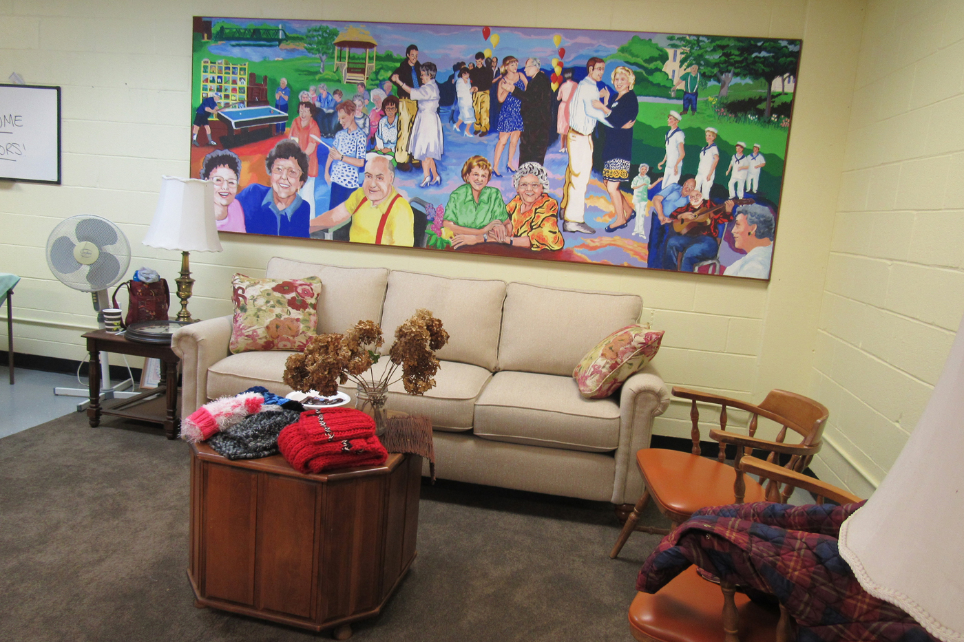 A Sitting Area With Comfortable Furniture, Area Rug And A Mural Moved From  The Lodge