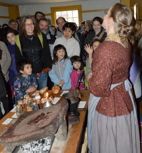 Preparing chocolate specialties brings a roomful of smiles during Genesee Country Village & Museum's Preparing for the Holidays program on November 18. Provided photo