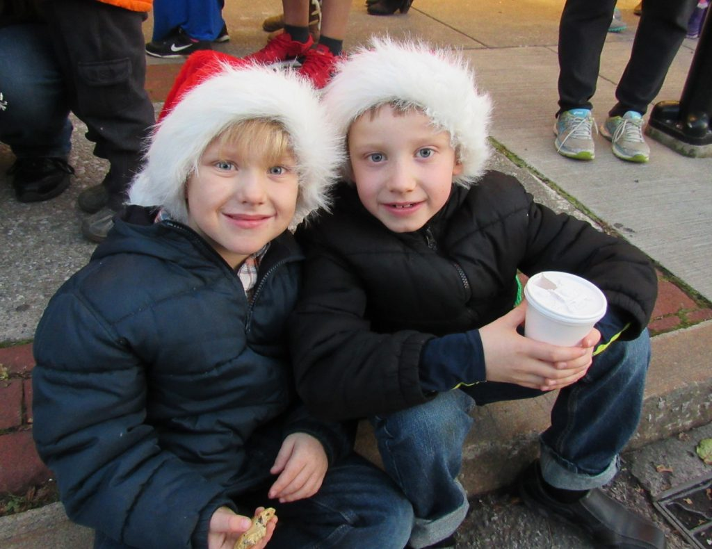 Crosby and Quinn Christy - ages 6 and 8 - of Brockport, enjoy refreshments prior to the start of the parade. Their family said they were having fun while an older sibling sang Christmas Carols nearby. K. Gabalski photo