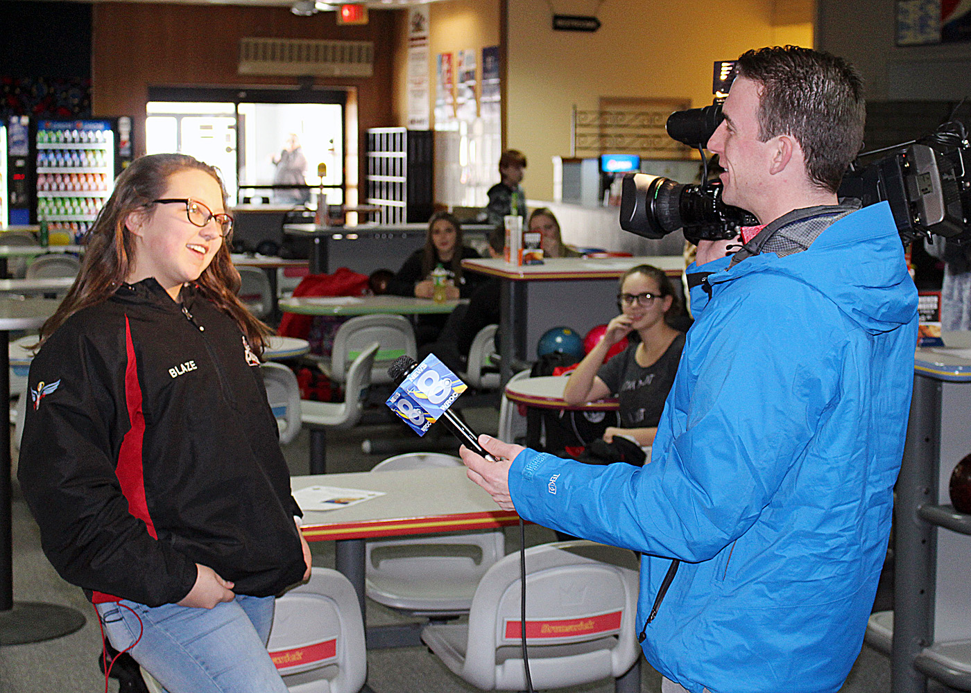 Elena Carr being interviewed for local television news.
