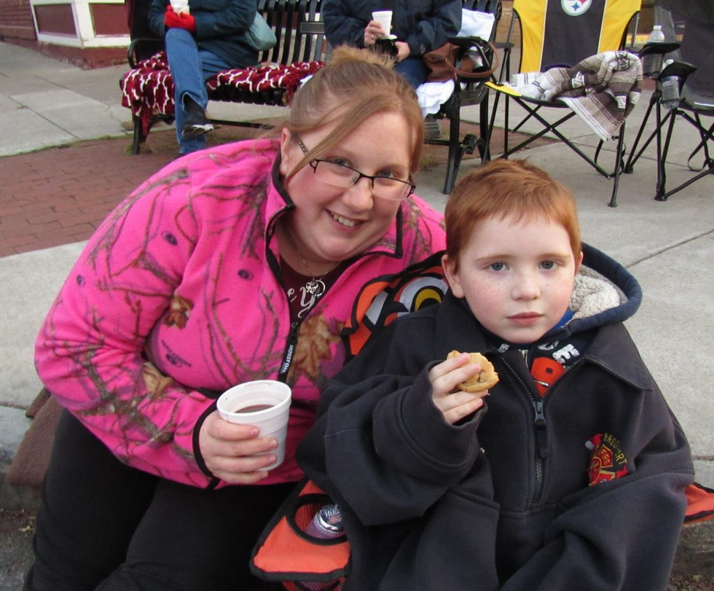 Genna Smith and her son, Aiden, age 4, were excited to see their family members march in the parade ... Aiden's dad is a member of the Brockport Fire Department. K. Gabalski photo