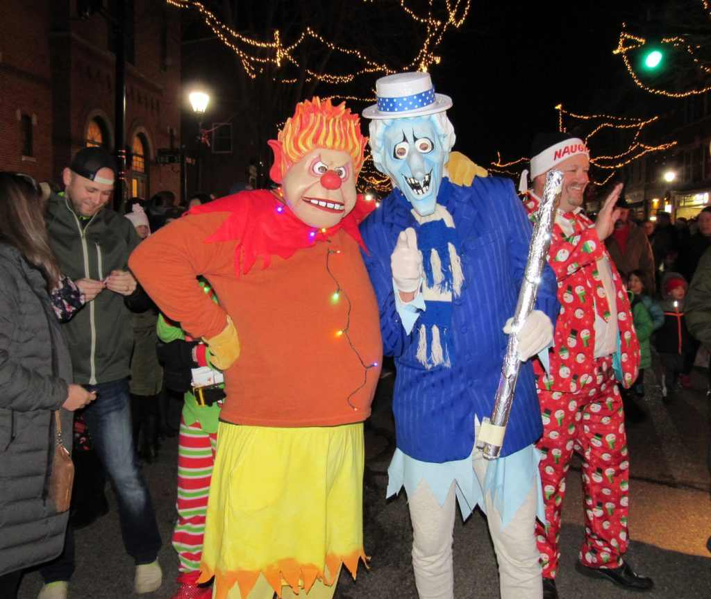 Heat Miser and Snow Miser from Santa's float mingled with the crowd following the parade. K. Gabalski photo