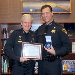 Undersheriff Andrew Forsythe receives Purple Heart medal from Sheriff Patrick O'Flynn. Provided photo