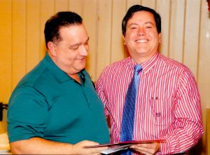 "St. Leo Grand Knight Jose Rivera (right) presents the ""Shining Armor"" award to Ron Bourret."