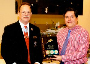 "New York State advocate Mike Flanagan (left) presents the ""Double Star Council Award"" to Grand Knight Jose Rivera."