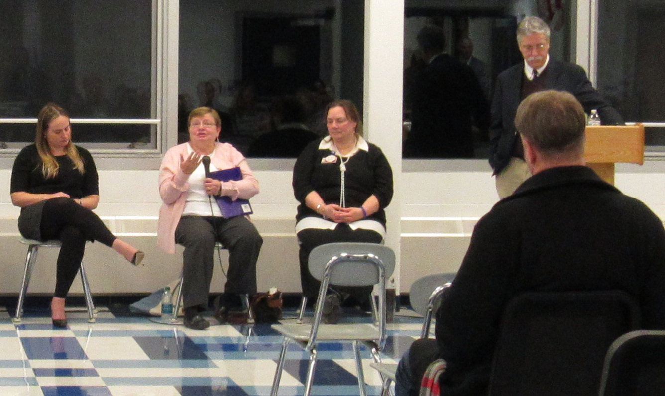 "Meredith Minier (holding microphone), who lost her husband to suicide, told those attending the Evening of Healing in Kendall January 16, not to beat themselves up with guilt after the loss of a loved one who has taken their own life. ""The only way to heal is to go through the brambles, not around them,"" she said."