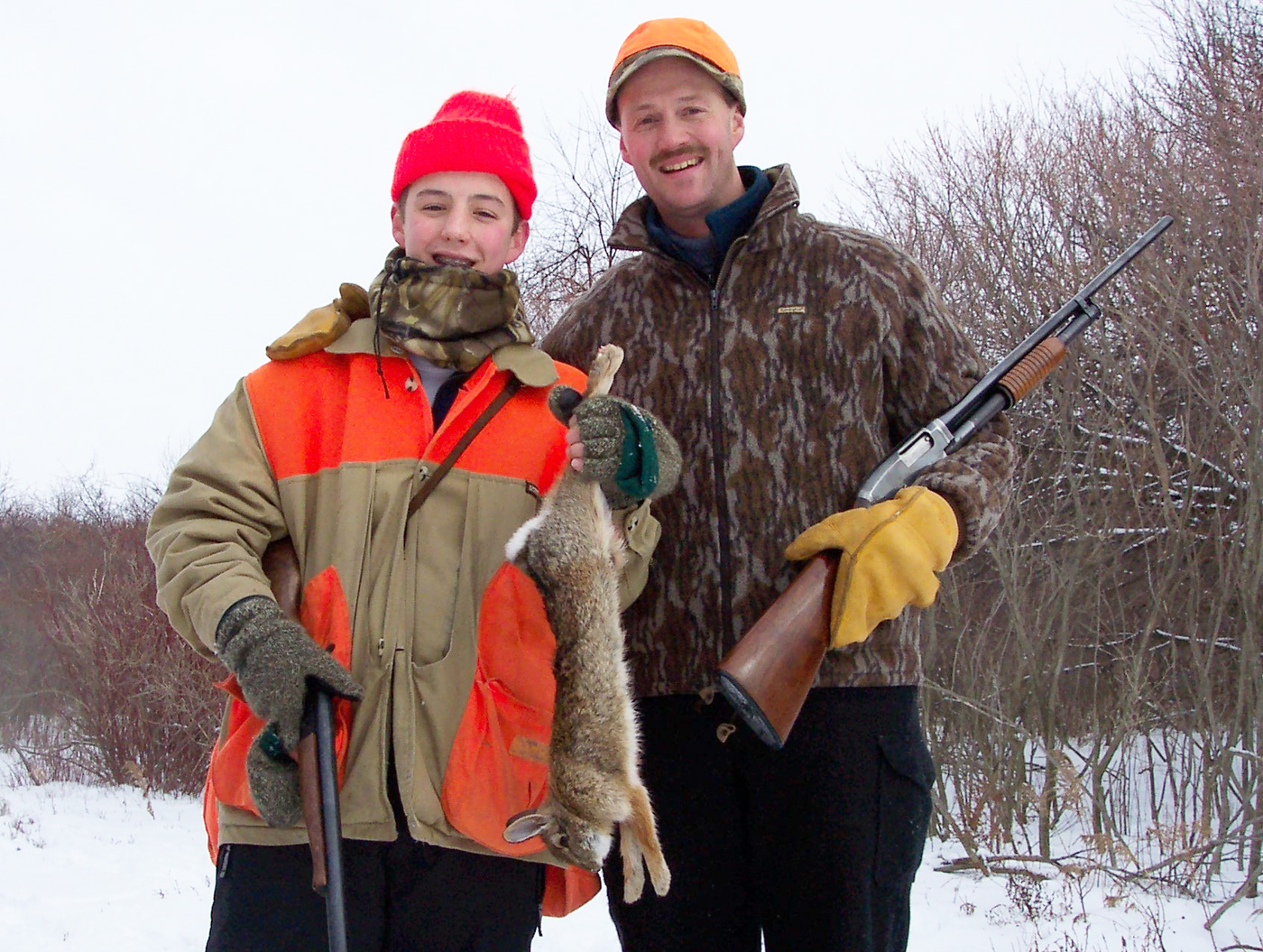 Will Falcheck (former Vet in Hilton and Spencerport) and son Jake with a tasty cottontail. Rabbit hunting with beagles is a great way to get a young hunter started. Provided photo