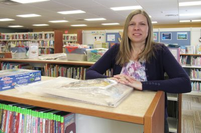 Christine Gates stands in the Children's/Young Adult section of the Hamlin Public Library, which has seen some changes since she became library director in December. K. Gabalski photo