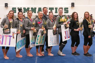 In picture l-r, Brockport senior gymnasts Brittany Vasile, Miranda Shaine, Bridgette Schaal, Erica Roth, Allison Hester, Jill Coyne with volunteer coaches Kayla Michnoff and Casey Attenberger and head coach John Feeney (second row). Provided photo