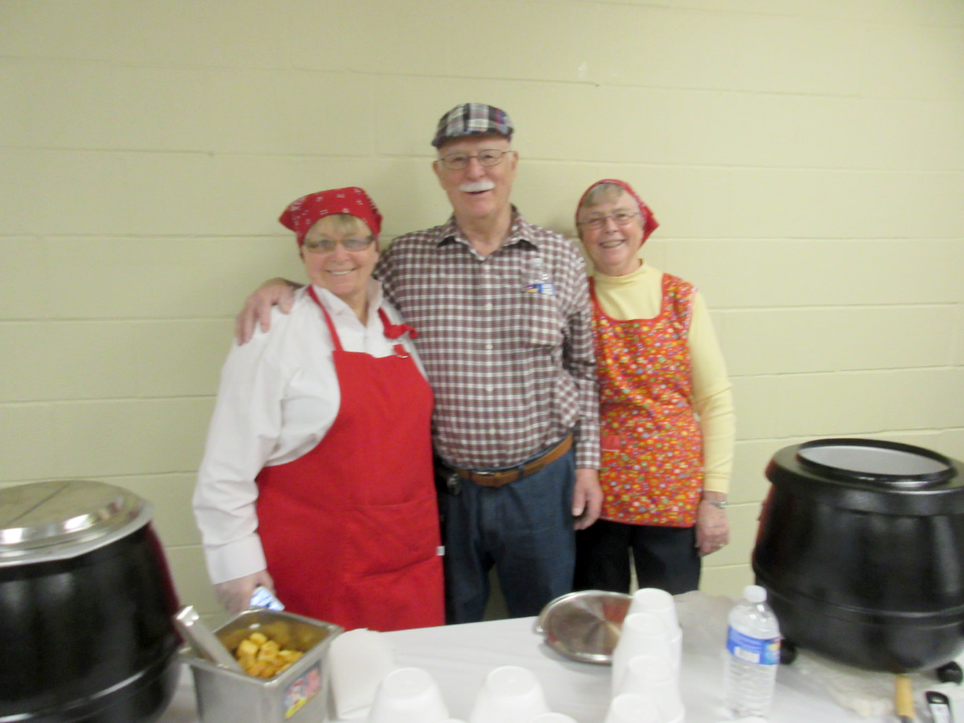 (Left to right): Volunteer server, Lori Skoog; Skip Perry, husband of Souper Bowl I chair, Andrea Perry.  Provided photo