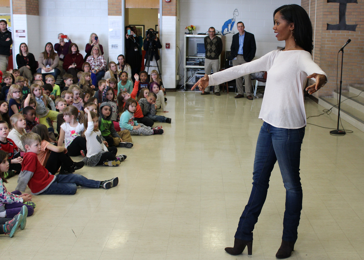 Now-retired ballerina Aesha Ash gamely performed chaînés turns in her high-heeled boots when the students requested  a dance move. Provided photo