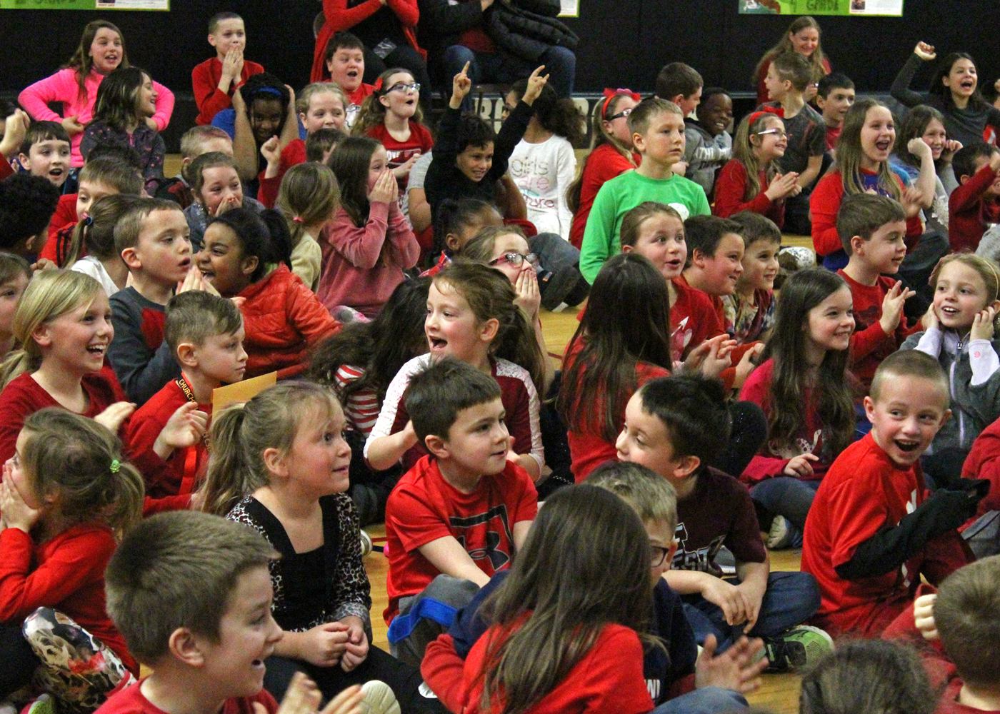 Students react with joy as they learn they've set a new record for this year's American Heart Association Hoops for Heart campaign. Provided photo