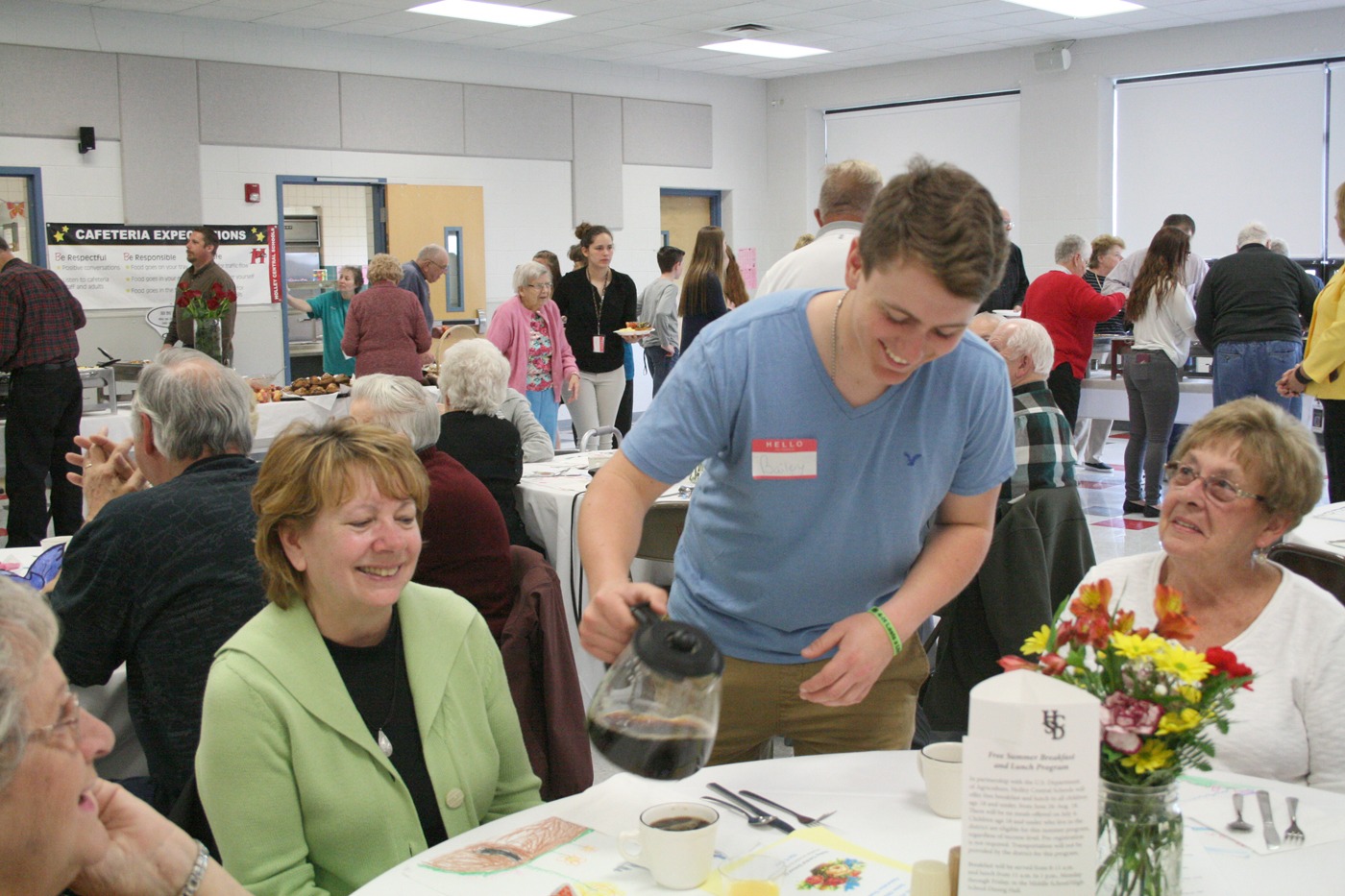 Senior Bailey Schubmehl pours coffee for attendees at the breakfast. Provided photo