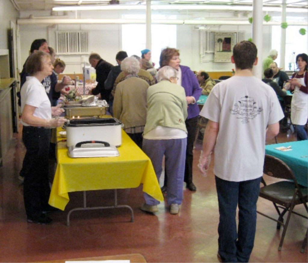 A group of over 12 volunteers served those in attendance at the first Loaf and Ladle in March. The next meal will be provided on April 29. Provided photo