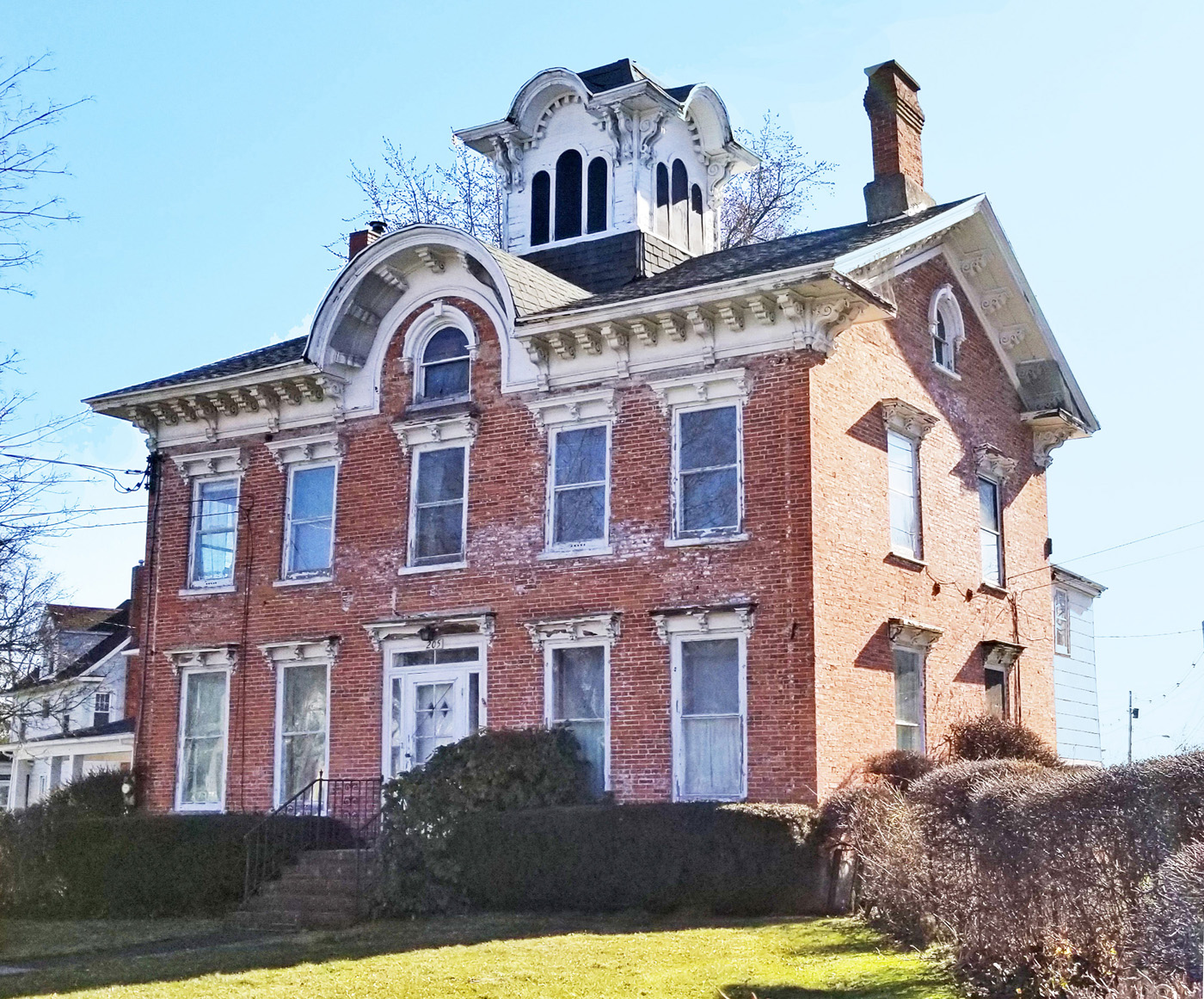 This stately building at the intersection of Main Street and Park Avenue has been a Brockport landmark for nearly 170 years.  Since 1851, it has changed ownership many times as a hotel, a nursing home, a private home, and a multi-family rental. In an estimated two more years, it will open as a Bed & Breakfast. Photo by Dianne Hickerson