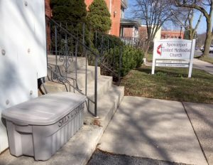 The collection bin is located beside the church's front steps. Provided photo