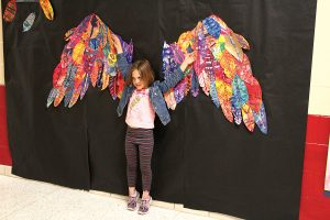 Selfie walls with hearts, butterflies and wings invited viewers to become part of the artwork.