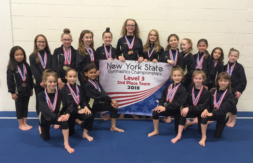 Bright Raven Level 3 Team with Banner: Kneeling in front (left to right) Samantha Clyde (Spencerport), Peyton Petrillo (Brockport), Rachel Lynck (Chili), Abby D'Ambrosia (Brockport), Isabella Curtis (Avon), Skylar Williamson (Chili). Standing back row: Kayla Doan (Ogden), Elliana Visca (Spencerport), Mary Cook (Brockport), Kelsey Magin (Spencerport), Eva Meddaugh (Greece), Annika Ahlstrom (Gates), Madison Gefell (Churchville), Anna Silivestro (Greece), Avery Overacker (North Chili), Sophia Hogan (Greece), Ava Marks (Scottsville), Caitlin Nowak (North Chili). Not in photo: Allison Moss (Spencerport). Provided photo.
