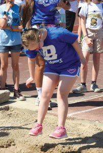 Brockport athlete participating in the Standing Long Jump.