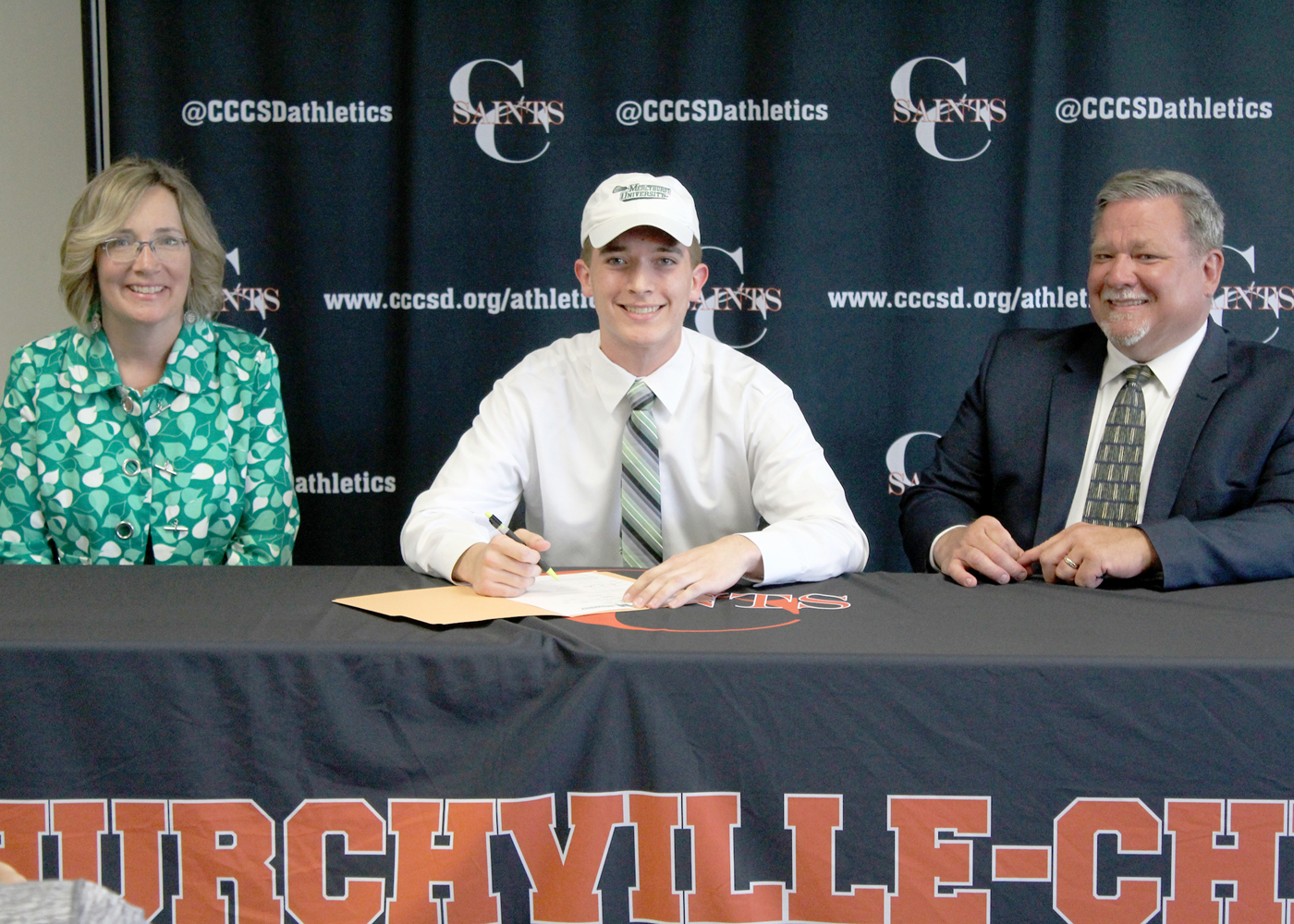 Churchville-Chili senior Ryan TerHaar, with parents Susan and Michael TerHaar, signs his letter of intent to join the Mercyhurst Lakers lacrosse team. Provided photo