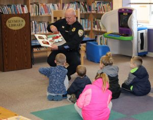 "Chief Mark Cuzzupoli reading to children at the Syemour Library during the Brockport Kiwanis Club's ""Reading Rocks!"" event in March. Provided photo"