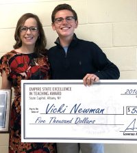 Hilton High School math teacher Vicki Newman receives the Empire State Excellence in Teaching Award after being nominated by her former student senior Michael Speciale. Provided photo