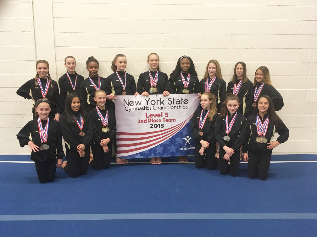 Level 5 Team with State Banner: Front – Kylie Montague, Katrina Daly, Lia Brasacchio, Jenna Reiss, Mary Sack, Kendall Mesh. Standing – Natalie Wood, Katie Bradfield, Morgan Sizer, Alyse Ahlstrom, Emily Post, Nyla Ragland, Meredith Fingler, Gabriella White, Paige Evans. Not in photo:  Olivia Bieber, Grace Gocher, Caroline Garbe. Provided photo
