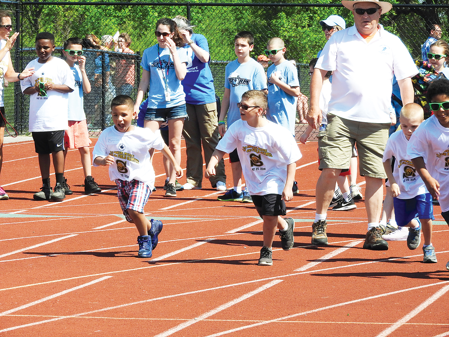 Spencerport athletes participating in 50M dash and various Youth Skills Station events.