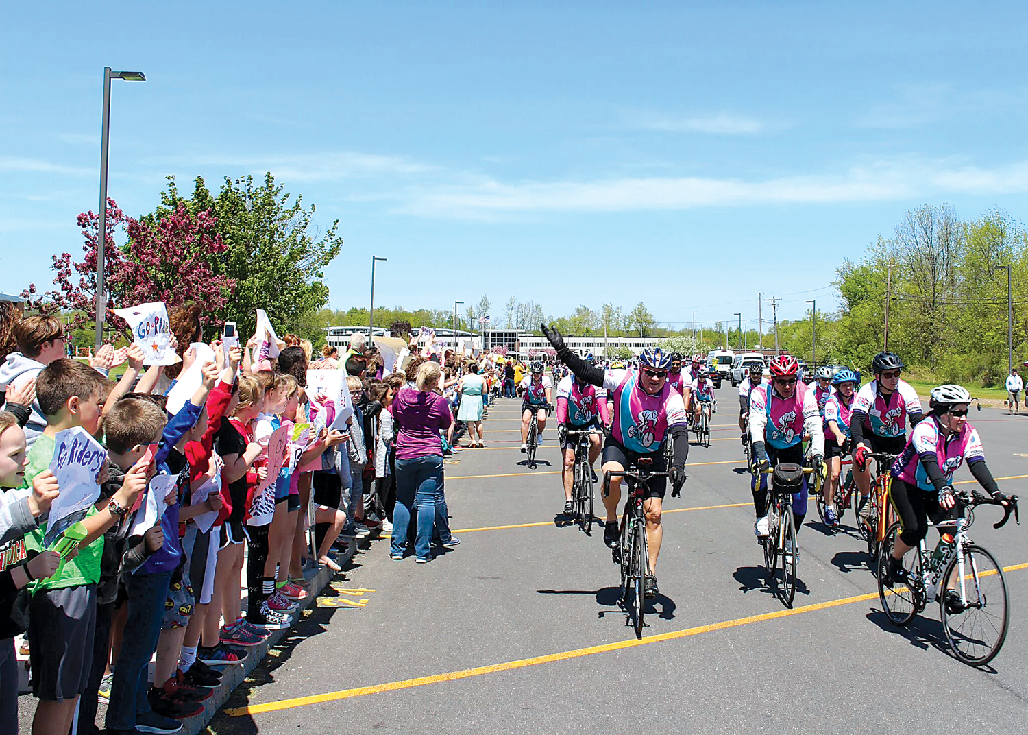 Participants rode their bikes past the cheering crowds of students and staff awaiting their arrival at Village Elementary School. Provided photo