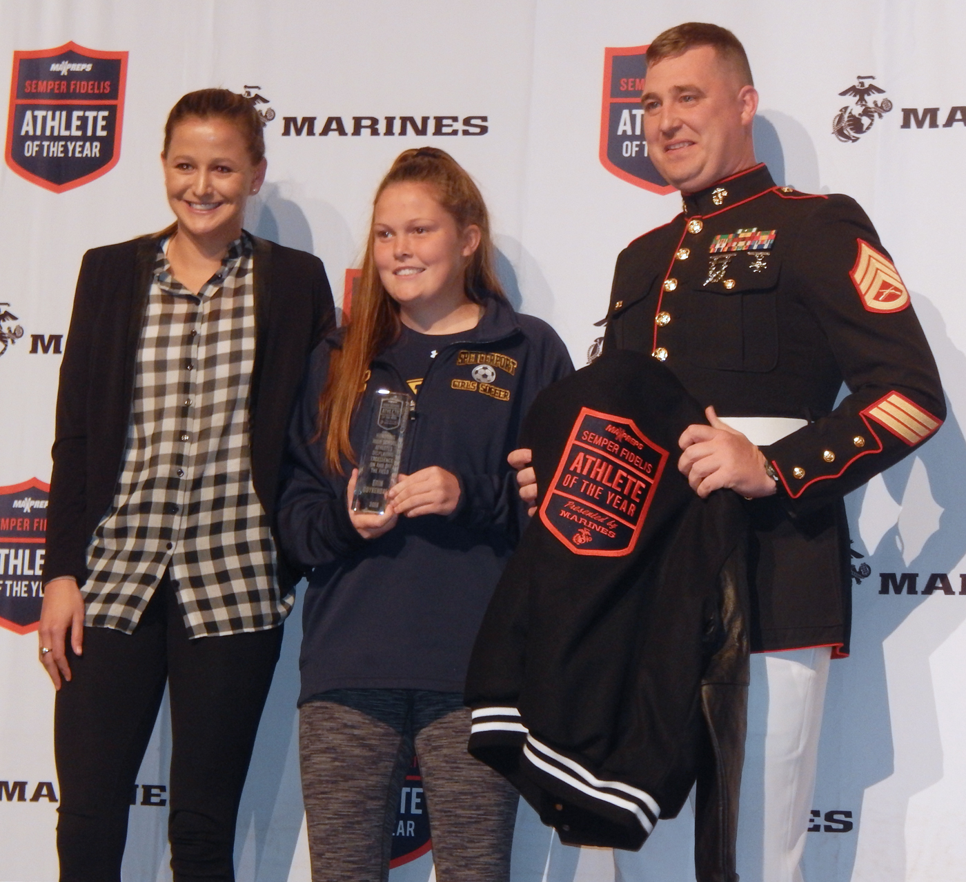 Carly Reed, Professional Lacrosse player for the New England Command, Erin Coykendall and Staff Sergeant Fetzer of the US Marines. Photo by Bill Stultz