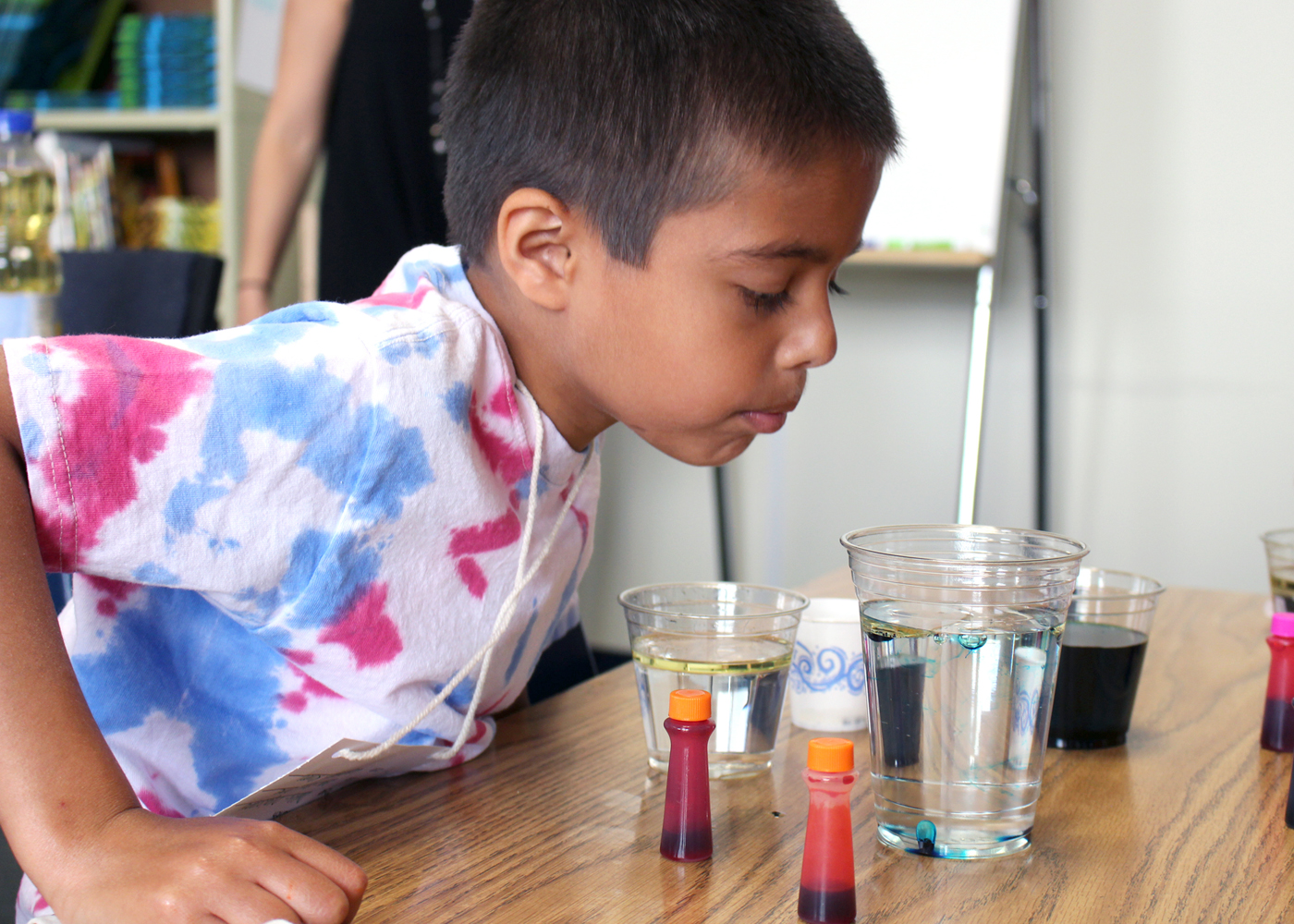 Quest Elementary School student Owen John, in Breanna Stanford's primary class, creates underwater fireworks during Science Fun Day. Provided photo
