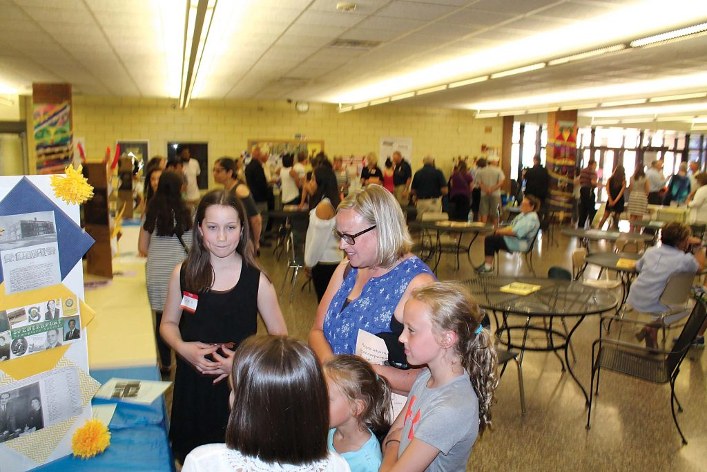 Students shared their findings with community members at the Spencerport Heroes event on June 12.