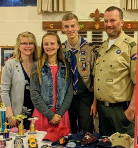 Thomas Walter of Troop 90 is pictured with his parents Christina and Thomas and sister Faith Walter.