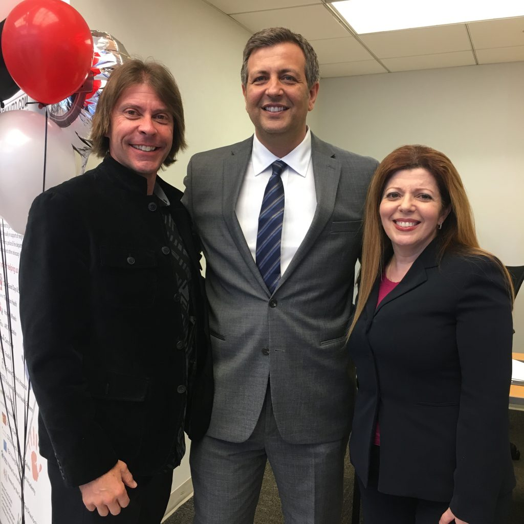 Vision Nissan Greece Owner Daniel Edwards and Partner Mario Marino with Greece Regional Chamber President & CEO Sarah Lentini at Vision's recent Grand Opening in Greece