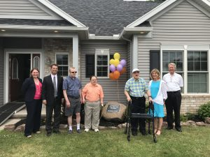 Left to right - Kate Munzinger, representing Joe Robach, David Meisenzahl, Board Chair, The Arc Foundation of Monroe, Peter, Guy, Gary, Barbara Wale, President/CEO of The Arc of Monroe, David Irish, Board Chair, The Arc of Monroe. Provided information and photo
