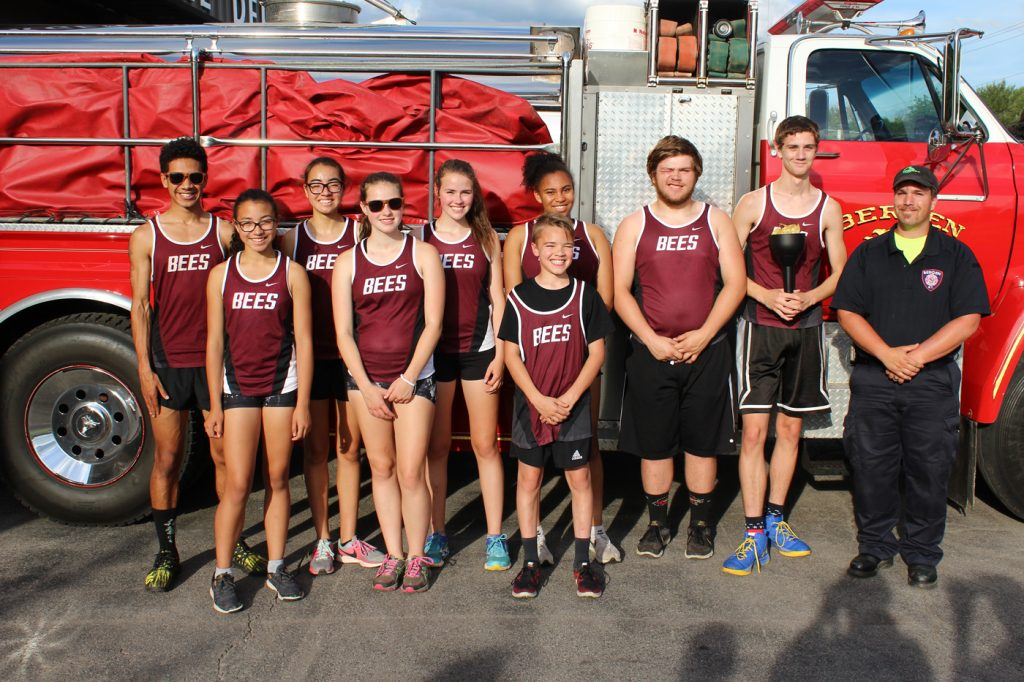 Proud Bees after the 2018 Jr. Olympic Torch Run, (l-r) Jerome Spinks, Dayanra Caballero, Siomara Caballero, Anna Hersom, Hope Hersom, Miriam Tardy, Josh Tardy, Paul McDermott and Travis Lambert with driver from the Bergen Fire Department. Provided photo