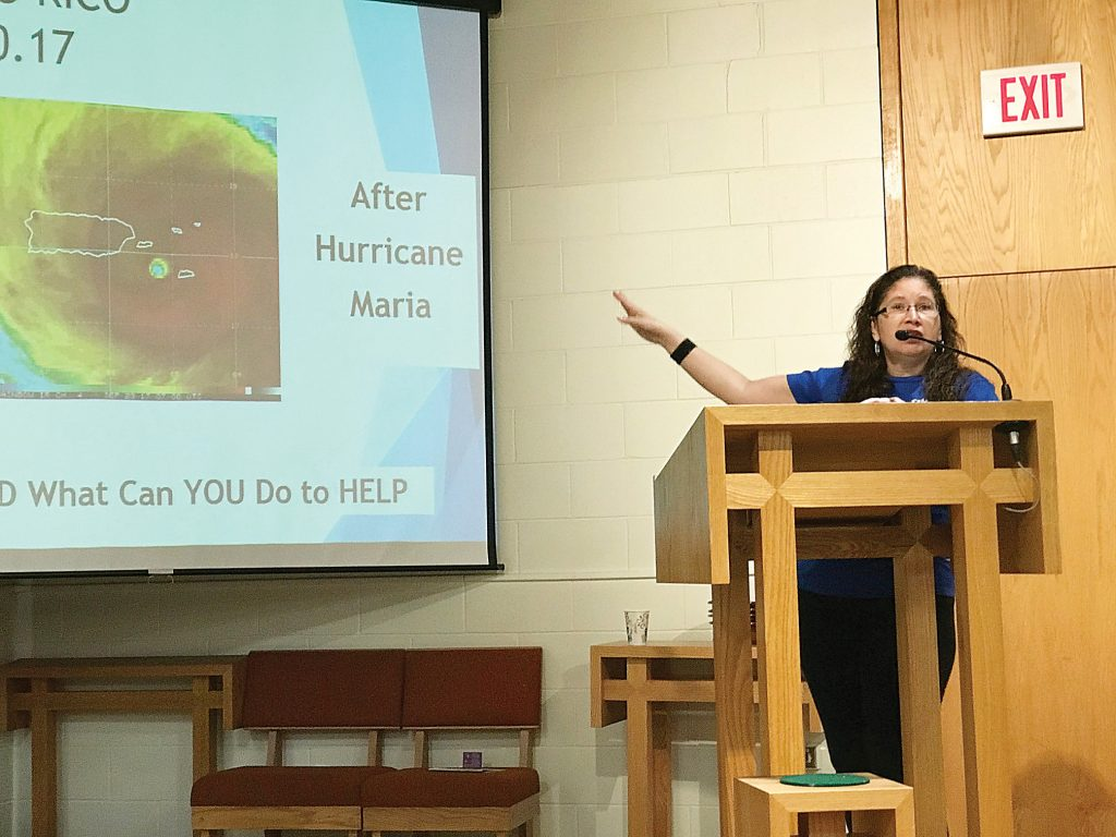 Maria Delgado Sutton, organizer of Puerto Rico One Box at a Time campaign, talks to parishioners at Trinity Emmanuel Lutheran Church in Gates about the extent of damage to Puerto Rico after it was hit by Hurricane Maria, a category 4 storm, last September. The church has adopted Puerto Rico One Box at a Time as their annual mission project. Provided photo