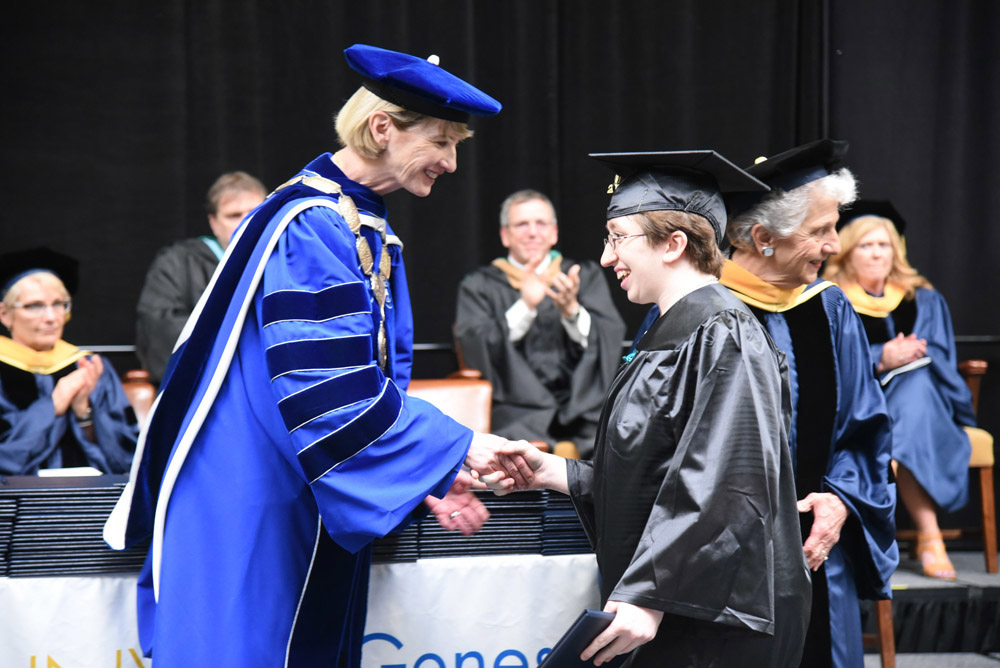 Lauren Stumpf shaking hands with SUNY Chancellor Dr. Kristina Johnson at GCC's 50th Commencement Ceremony on May 20, 2018. Provided photo