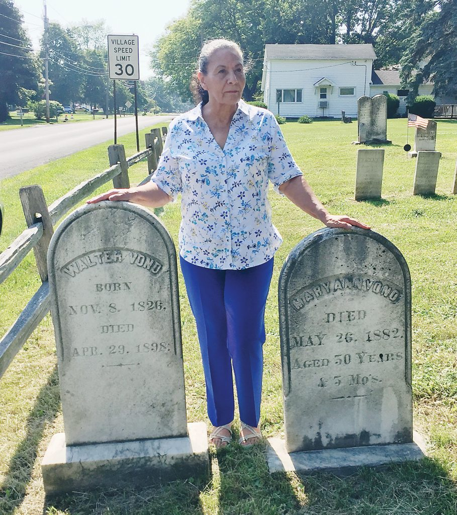 Lonie Wilson by the graves of Walter and Mary Vond. This was the first known visit to the area by Vond family members since 1898. Provided photo