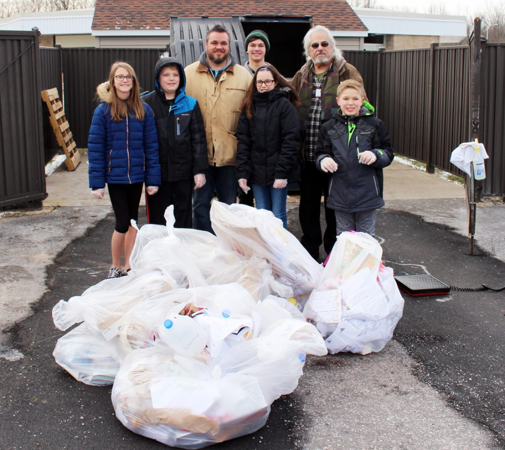 Students at Northwood Elementary School (front, l-r) Meredith Harnden, David Padolesski, Evelynn Smolinski and Reilly Deming worked with the team from Impact Earth, Robert Putney, Elias Putney and Tom Mangialino, on a waste audit. Provided photo.