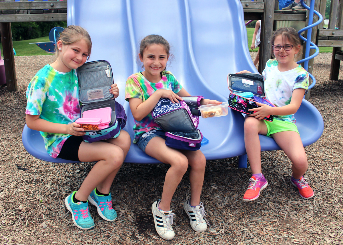 Students in Katie Paxton-Johnson's class at Quest Elementary School packed zero-waste lunches using all re-usable containers. Shown are: (l-r) Morgan Meyer, Sophia Sciortino and Stella Gebbie. Provided photo.