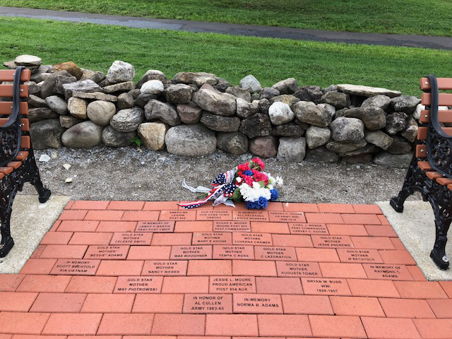 The Hometown Heroes bricks are located between the benches in the Community Memorial Park. Photo by Pamela A. Moore
